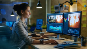 woman working on video creation on computers
