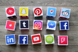 social media cubes with wooden background